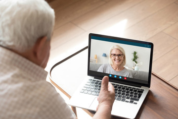 Spoed Fotobehang Wanddecoratie met eigen foto Pc screen webcam view 60s daughter chat with 70s dad by video call relatives share news show warm relation enjoy distant communication on-line. Old generation easy comfort usage of modern app concept