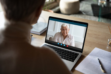Keuken foto achterwand Wanddecoratie met eigen foto View over medical insurer shoulder, consulting old client on-line by videoconference app. Adult daughter talks with mature dad who lives in country or nursing home. Virtual meeting modern tech concept