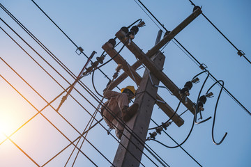 The power lineman uses insutated tool to open the connection of the transformer from the high voltage distribution system. To change the drop out fuse cut out that protects the transformer.