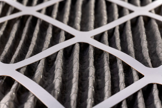 Close up of home air filter showing the dirt and particle cause bacteria inflection and sickness.