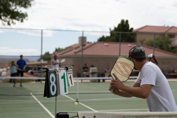 man playing pickleball