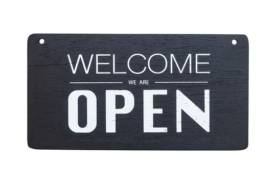 welcome we are open sign on black wooden board isolated on white background