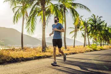 Runner wearing medical mask, Coronavirus pandemic Covid-19. Sport, Active life in quarantine surgical sterilizing face mask protection. Outdoor run on athletics track in Corona Outbreak. Keep your Wall mural