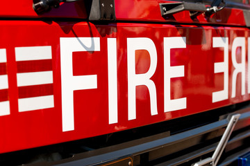 Close up of FIRE sign on the front of a British fire engine. Wall mural