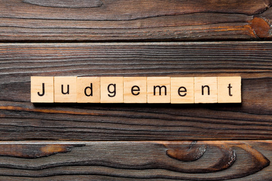 judgement word written on wood block. judgement text on table, concept