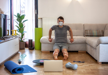 man exercising doing workout at home in mask Wall mural