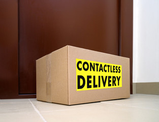 Contactless delivery. Left delivery box at the door during the quarantine. Apartment entrance with delivered box. Control Epidemic Prevention measures of coronavirus.