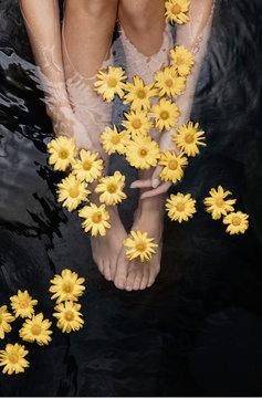 Feet of a woman enjoying thermal spa treatment