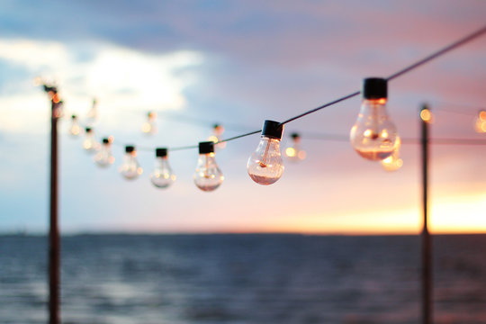 String Lights during sunset. Sea background. Abstract background.