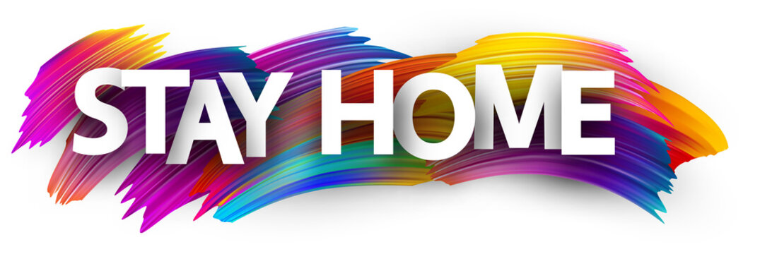 Big stay home sign over brush strokes background.