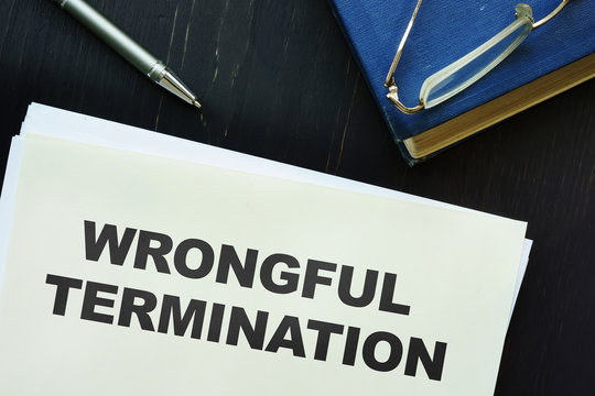 Text sign showing hand written words wrongful termination