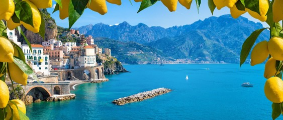 Poster Coast Small town Atrani on Amalfi Coast in province of Salerno, Campania region, Italy. Amalfi coast is popular travel and holyday destination in Italy. Ripe yellow lemons in foreground.