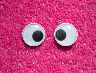 Funny Wiggle Google Eyes on Red Furry Fabric Silly Background