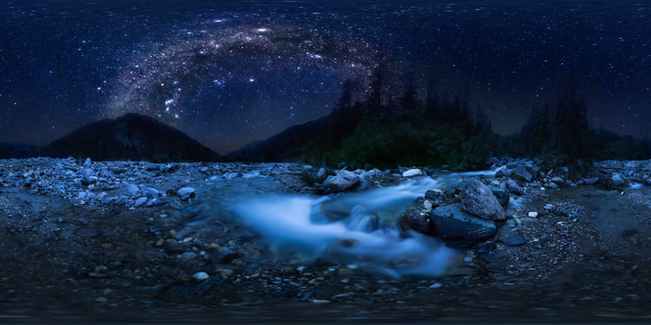 the milky way arc over mountain river in the middle of the forest on a long exposure. Spherical panorama 360vr