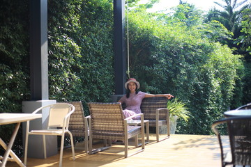 Woman sitting in a green garden