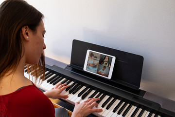woman having video chat with friends and playing music Fotobehang
