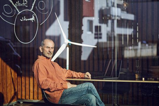 Senior engineer sitting in his environmentally friendly office