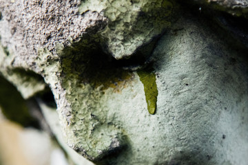 Fototapete - Close up fragment of an ancient statue of crying angel with tears in face as symbol of death and end of human life.