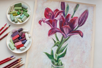 Red lilies drawing with soft pastel chalks and pencils