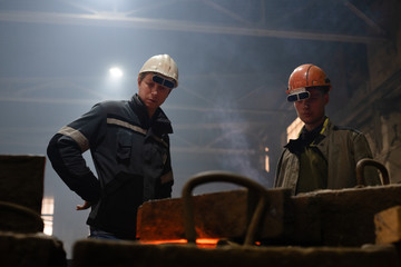 Foundry employees working with mold