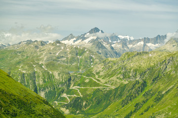 Wall Mural - View on Grimsel high mountain pass and surrounding mountains in Swiss Alps