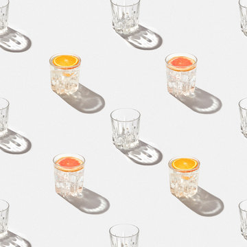 Close up of cocktail glasses with citrus fruit slices on table