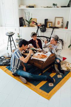 Friends Having Food During Weekend Party
