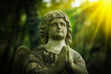 Fotomurales - Ancient stone statue of  little guards angel. Love, faith, hope, Christianity concept