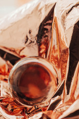 Pink gold or copper and crystal ball abstract shot