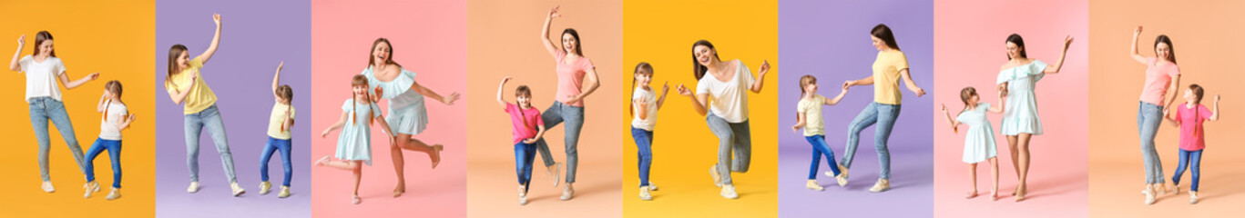 Happy mother and her little daughter dancing against color background
