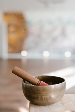 Wooden mortar and pestle in light room