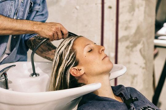 Hairstylist Washing Hair of Female Customer