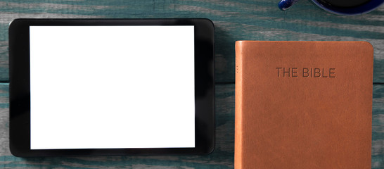 A Tablet with a Bible for LIve Streaming Church Services or Bible Study Fototapete