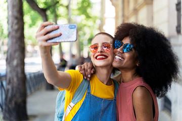 Beautiful lesbian couple taking a self portrait at the Street