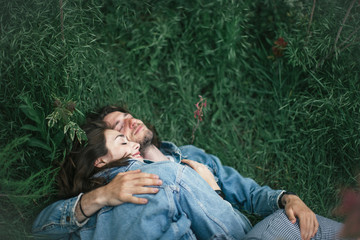 young couple lying on a grass