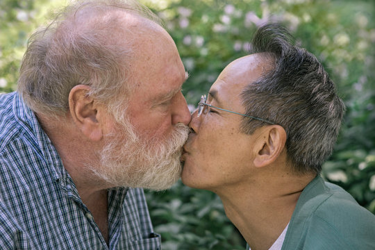 Senior Gay Couple Kissing in a Park