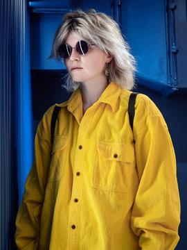 Fashionable portrait of a beautiful girl in a yellow shirt