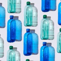 Different plastic bottles on a light background