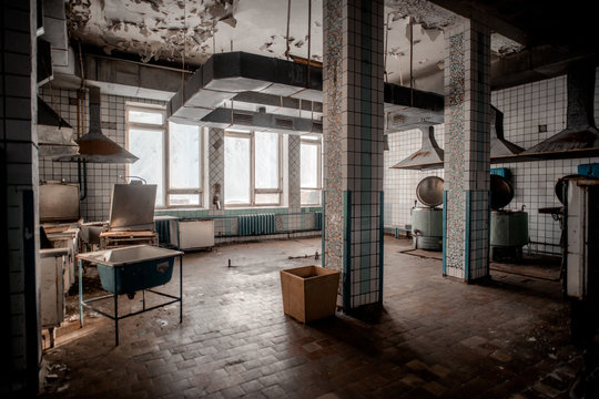 Old shabby kitchen in abandoned building