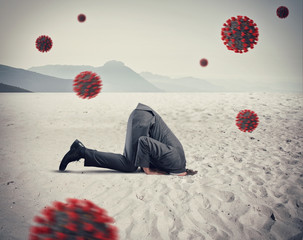 Fotorolgordijn Struisvogel Man hides himself like an ostrich due to coronavirus covid19 problem in the air