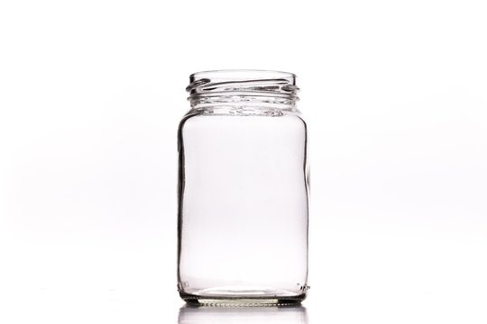 Closeup shot of an empty glass jar isolated on a white background