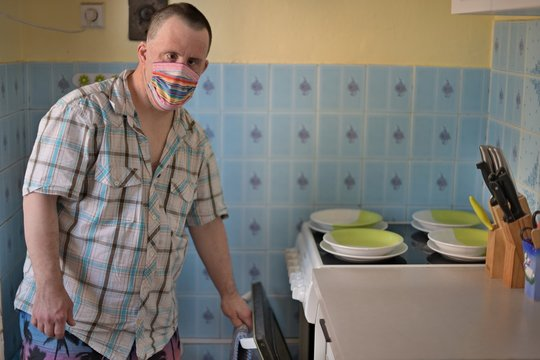 man with down syndrome with respirator mask