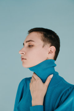 Model in sweater on light blue background