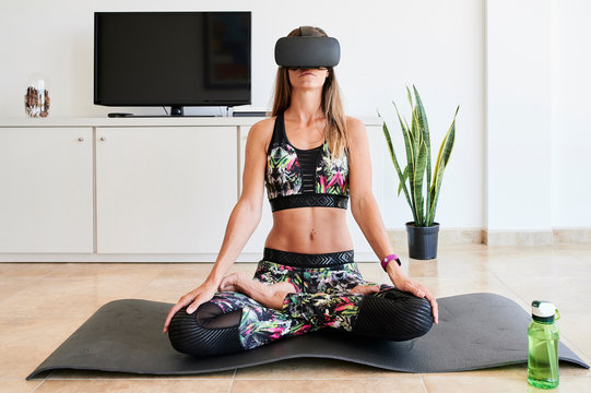 Yoga e-learning lessons with VR headset at home.