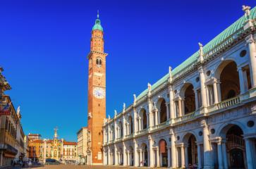 Foto auf AluDibond Dunkelblau Basilica Palladiana renaissance building, Torre Bissara clock tower and Loggia del Capitaniato Lodge in Piazza dei Signori square in old historical city centre of Vicenza city, Veneto region, Italy