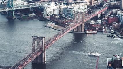 Wall Mural - Slow motion aerial view of traffic along Brooklyn and Manhattan Bridge, New York City