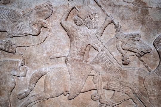Ancient persian bas-relief depicting warriors on horseback