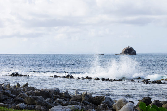 splashing water and wave crashing rocks with beautiful coastal scenery