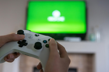 Everett, Washington - April 6, 2020: Xbox Remote contol used to play game on Microsoft Xbox console at home