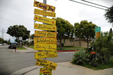A neighborhood sign thanks essential workers as the spread of the coronavirus disease (COVID-19) continues, in Santa Monica